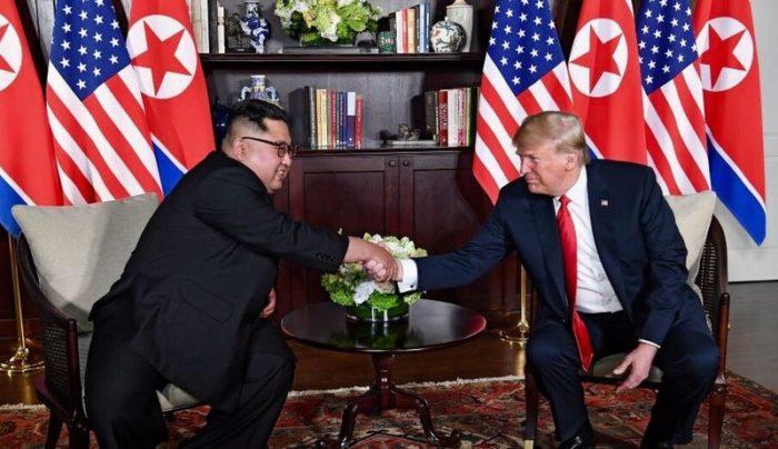 Trump and Kim shaking hands. than a handshake next time. (Wikimedia)